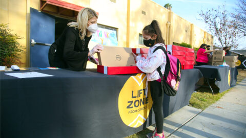 Comcast Gifts 225 Boys & Girls Club of Fresno County youth a lap
