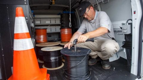 Tech in truck with fiber