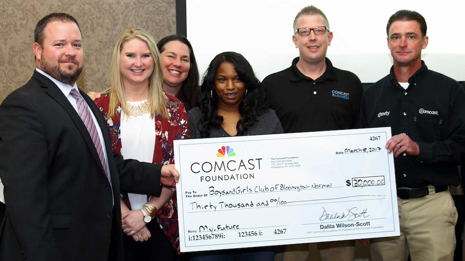 Recipients from Boys and Girls Clubs of Bloomington-Normal receiving check