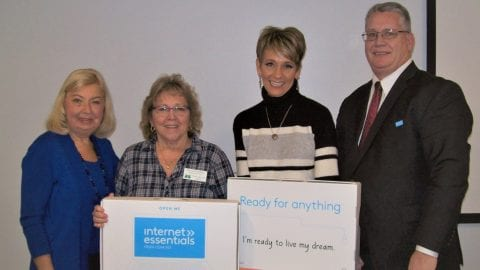 Four presenters at the Internet Essentials Champions event.