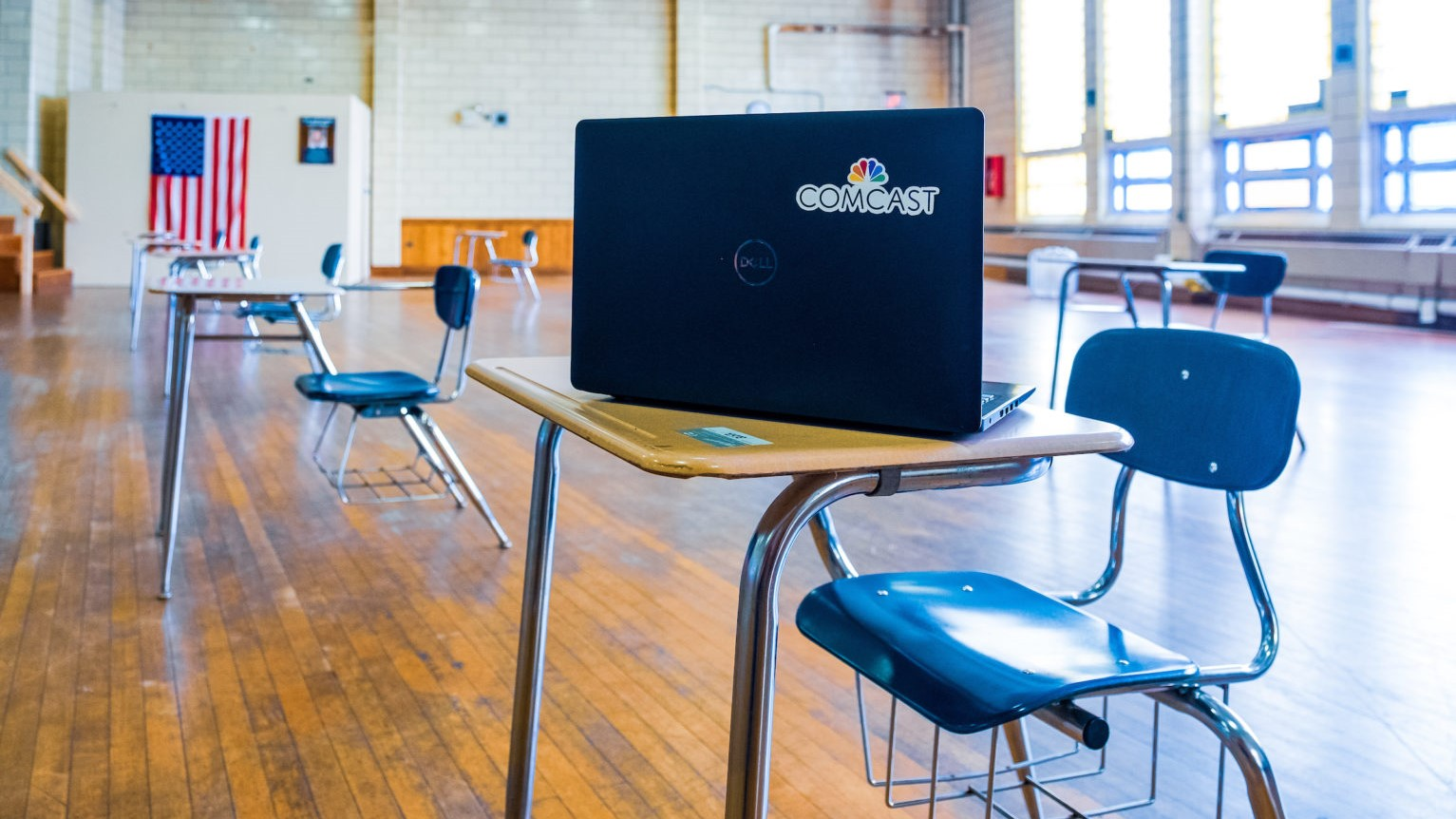 A desk and laptop inside a Lift Zone community center.