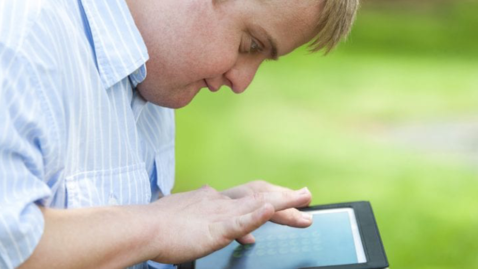 Male using a tablet.