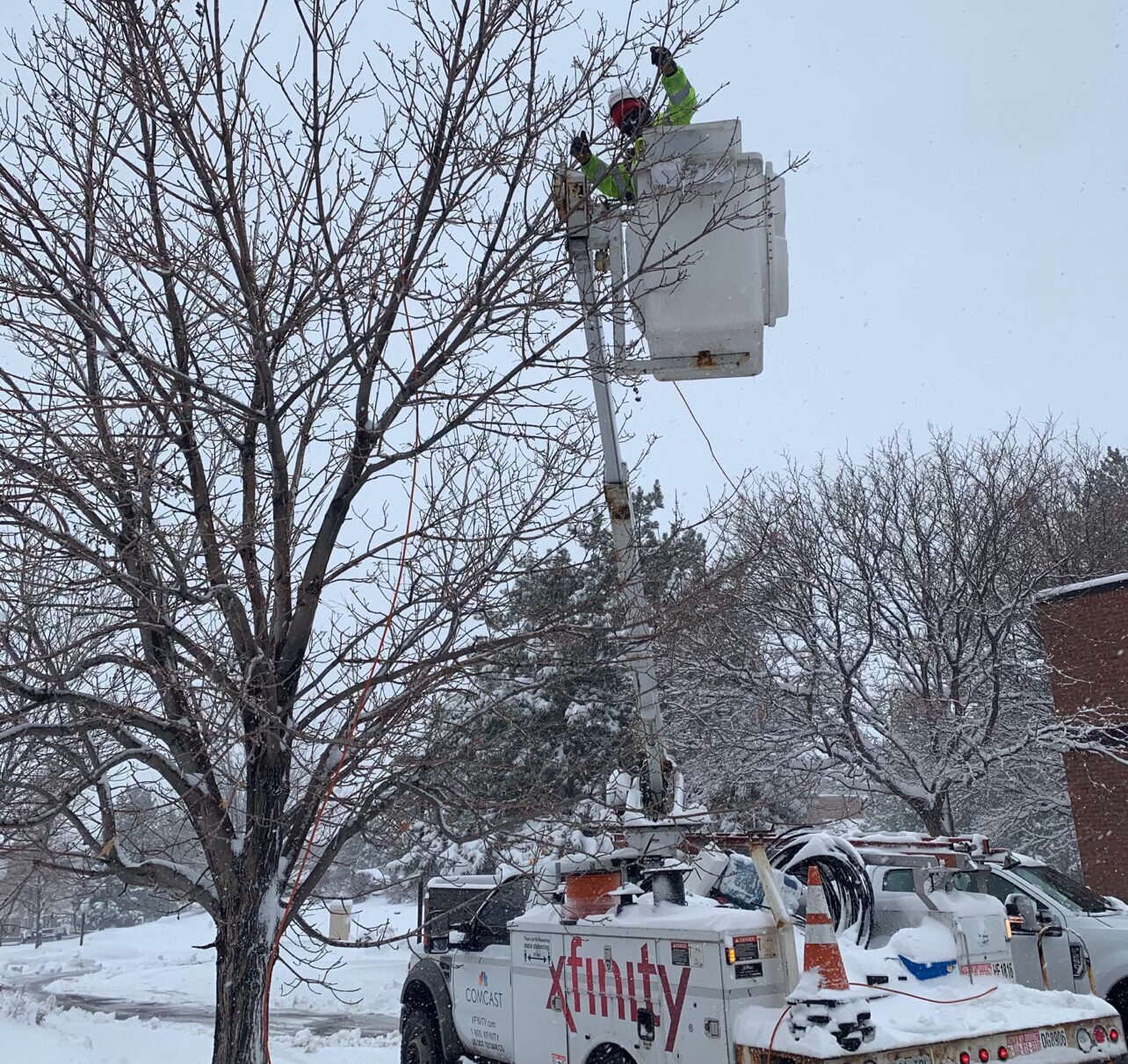 Comcast technician working after a snowstorm.