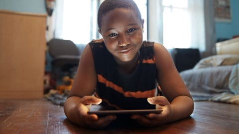 Young boy trying out 'internet essentials'