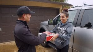 An Xfinity technician helps a customer.