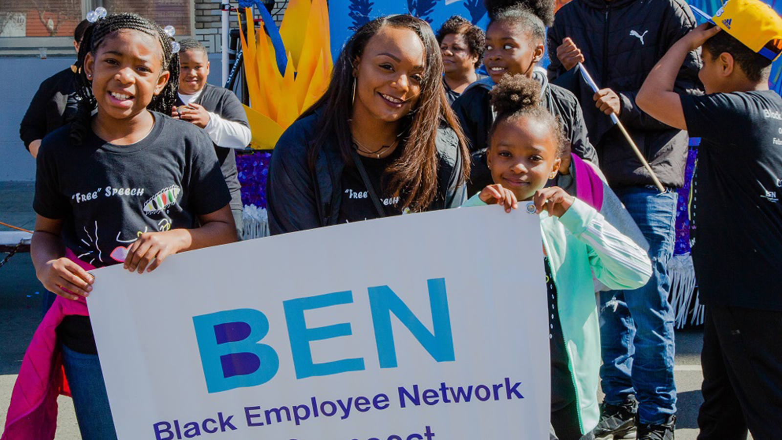 The #BEN Black Employee Network Signage Held By Youth Members