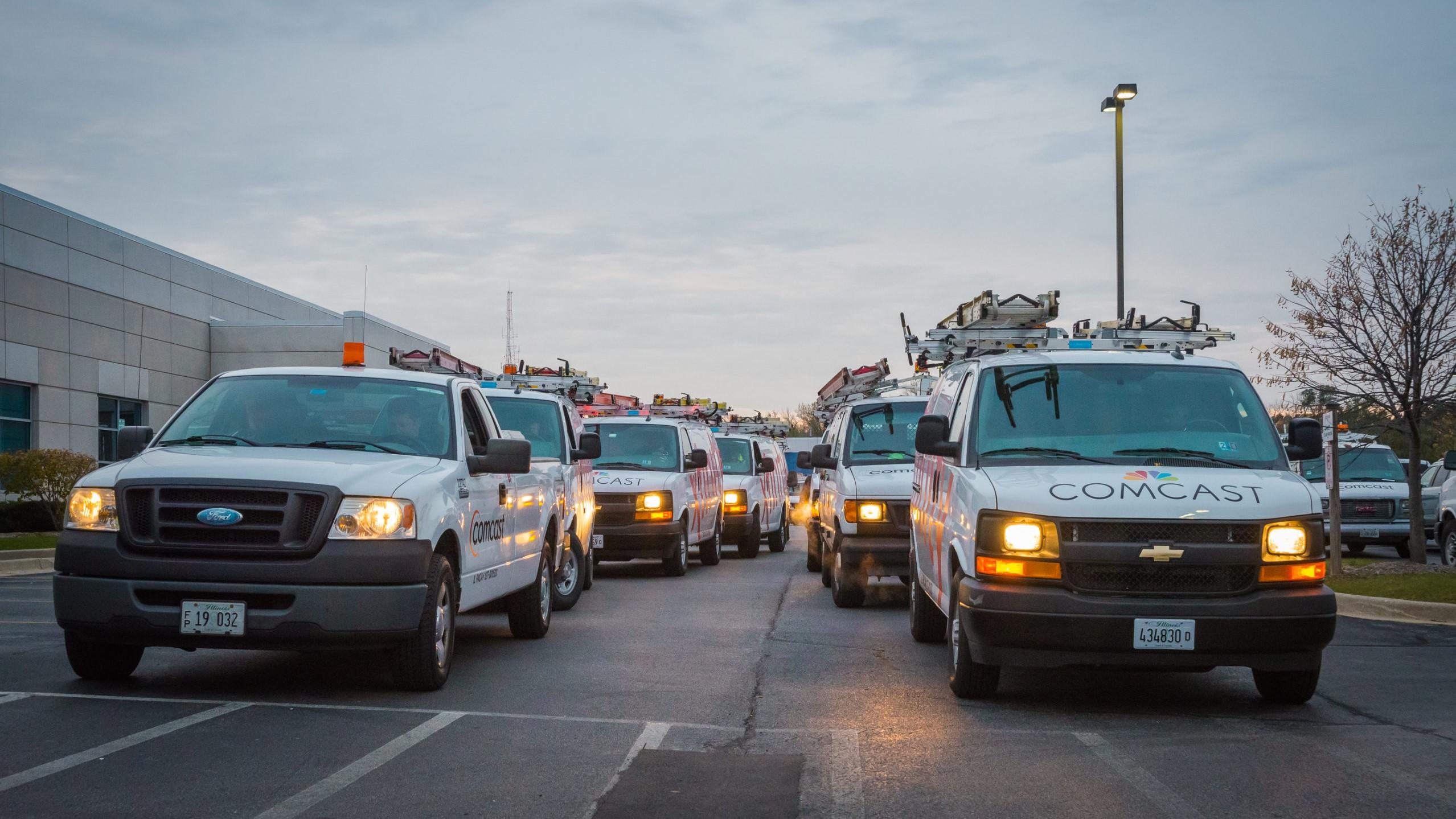 Comcast technicians in their vans