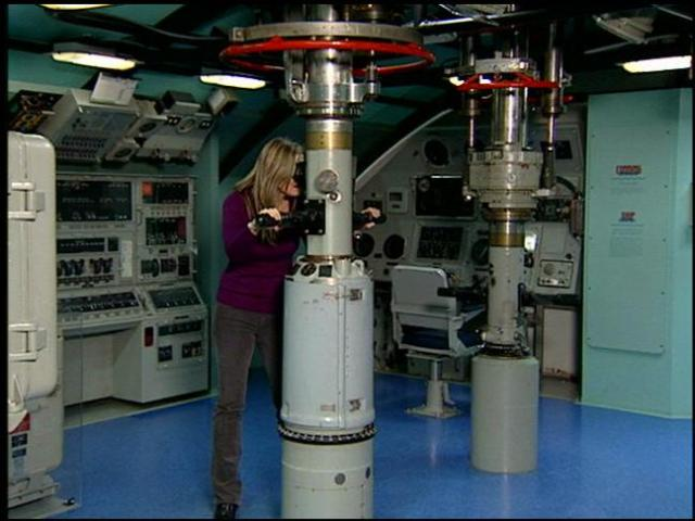 Sabrina Register looks through a periscope
