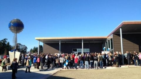 crowd gathered for ribbon cutting of Bremerton Teen Center