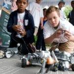 students driving small robots
