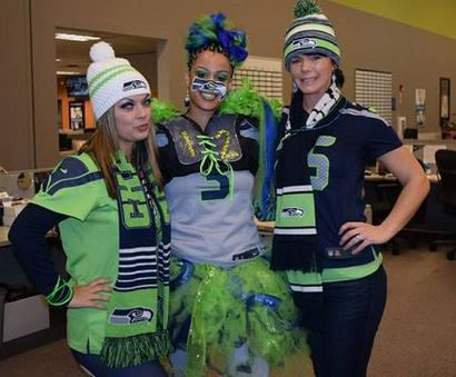 three comcast employees wearing Seahawks colors