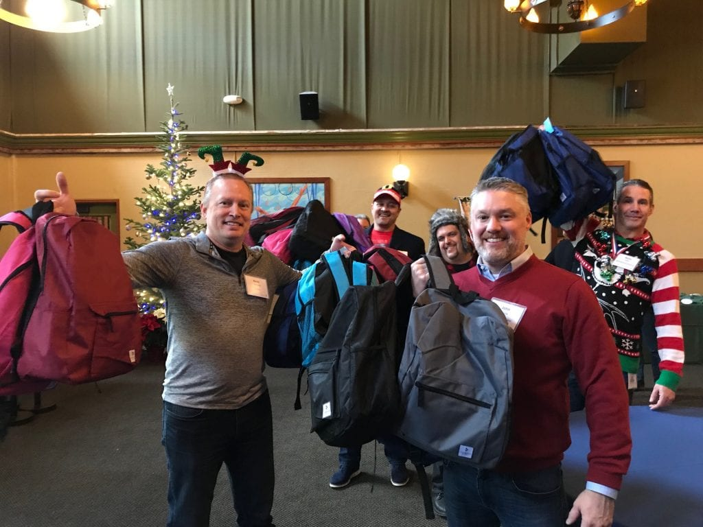 Comcast Washington state executives pack holiday kits for the homeless and Mary's Place