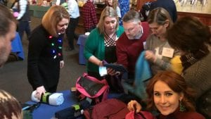 Volunteers fill backpacks for Helping the Homeless.