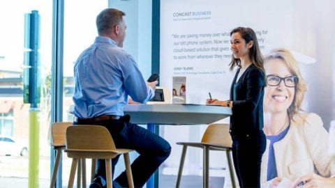 Male and Female having a conversation at an Xfinity Store.