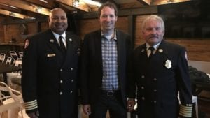 Greg Fee and member of the Minneapolis Fire Department.