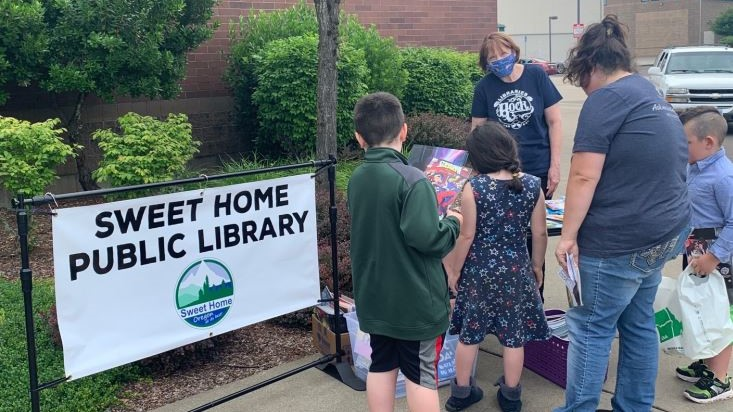 People gather in front of their local public library