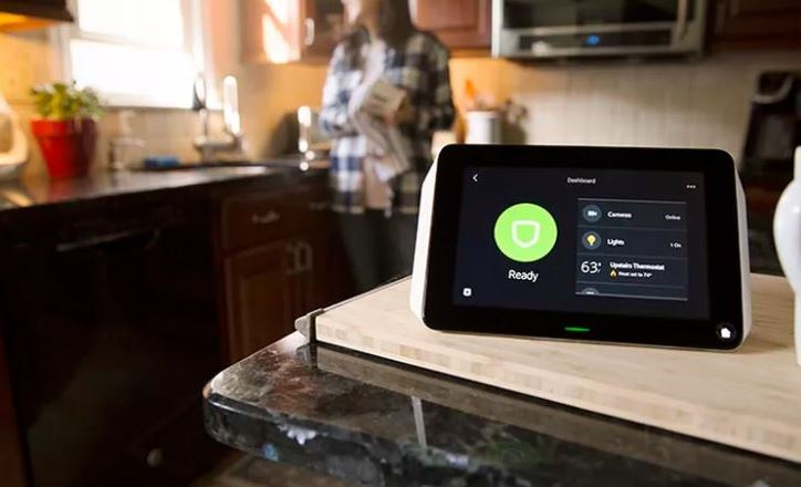 A tablet displays the Xfinity Home app