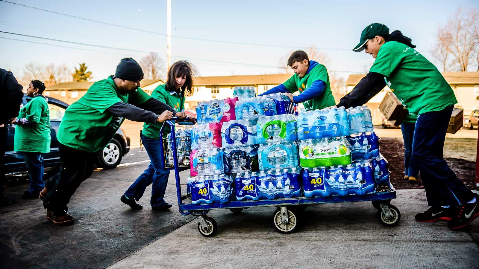 CCD volunteers with bottles of water