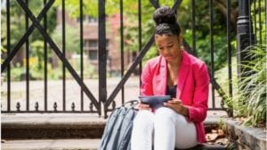 An Oakland University student uses her tablet.