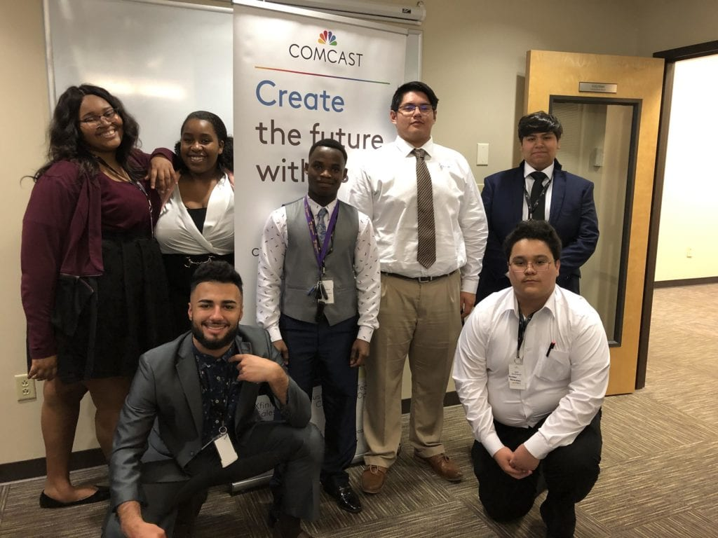 Young professionals posing for a photo