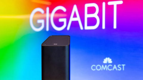 An Xfinity xFi gateway displayed in front of the Comcast logo.