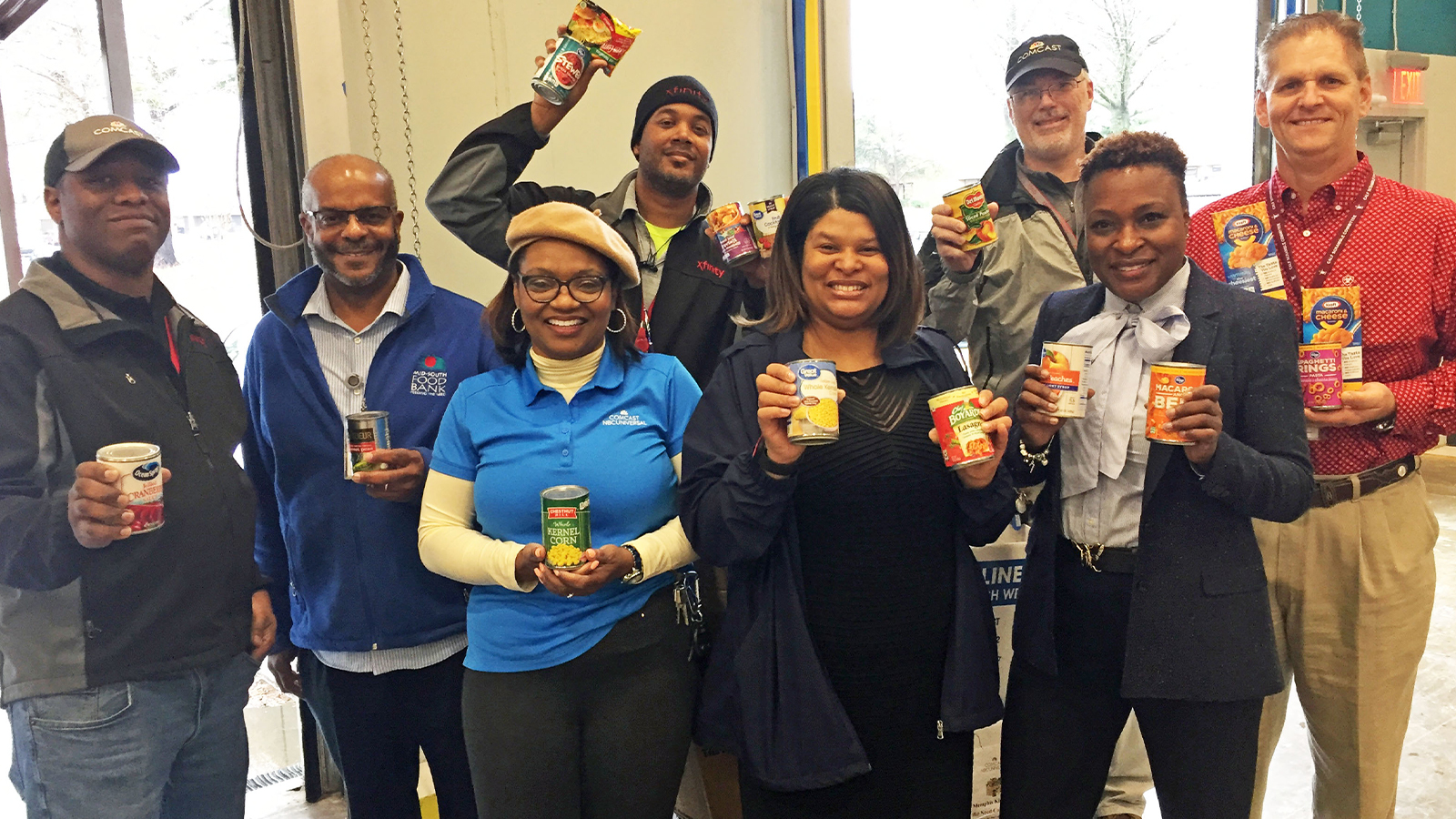Comcast employees donating their time at a Food Drive