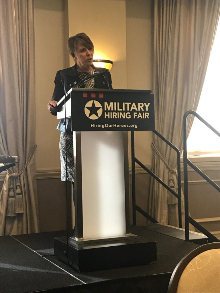 Senior Vice President of Military and Veterans Affairs for Comcast, Brigadier General (Ret.) Carol Eggert onstage at a military hiring fair.