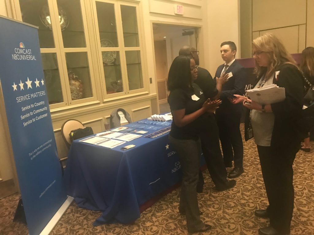 The Comcast NBCUniversal Service Matters booth at a military hiring event.