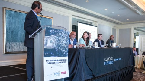 Panelists onstage at the Transforming Banking Through Technology panel.
