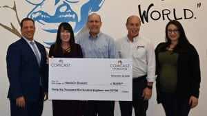 Dawn Stagliano, Director of Government Affairs and Community Impact for Comcast in Broward County, presented HandsOn Broward with a check.