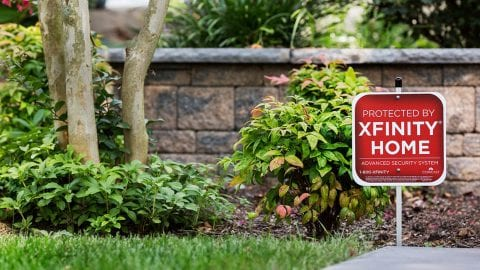 An Xfinity Home sign staked into a lawn.