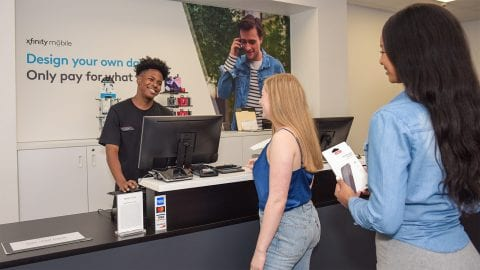 Comcast employee assisting customers.