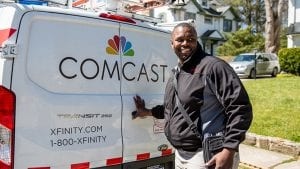 Comcast technician at the back of his truck.