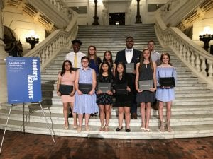 Students who won Comcast scholarships standing on Pennsylvania Capitol steps