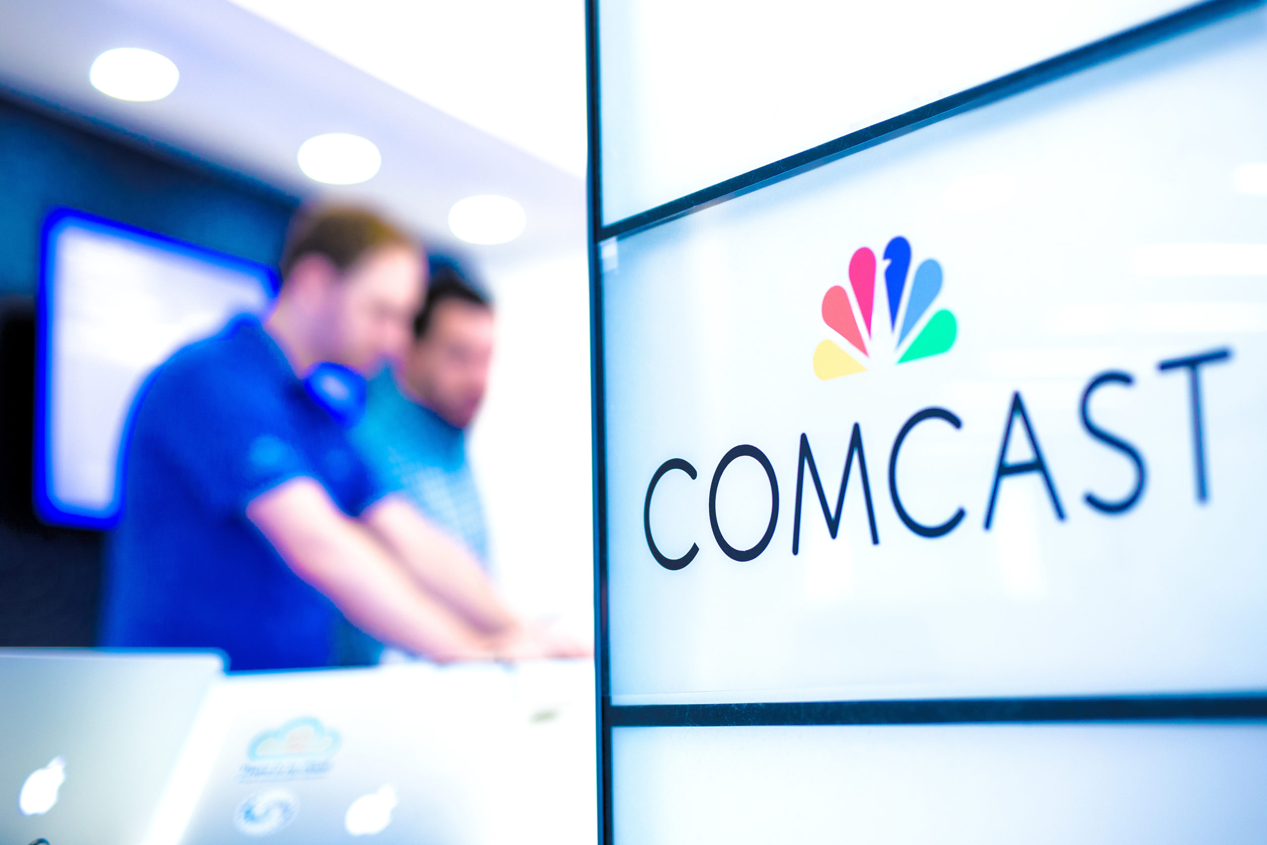 Comcast logo in forground