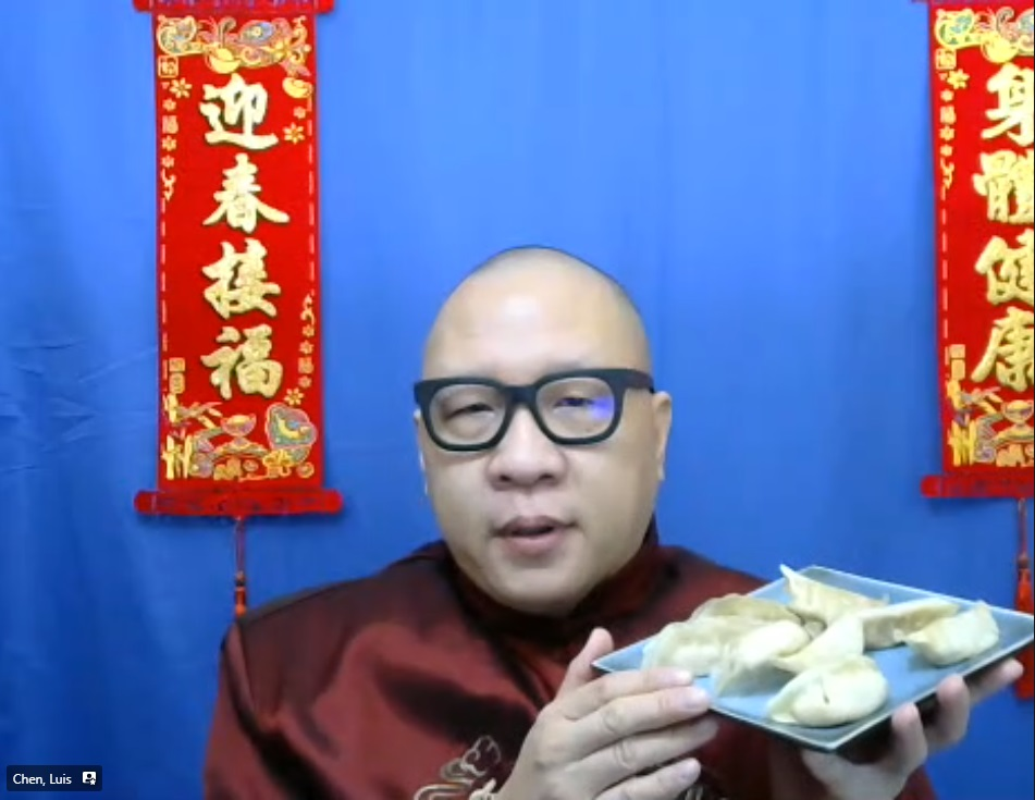 Man holding a plate of dumplings