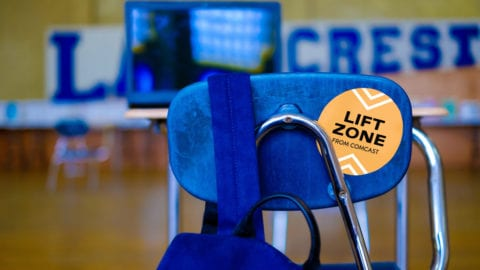 Backpack handing on chair inside Comcast Lift Zone
