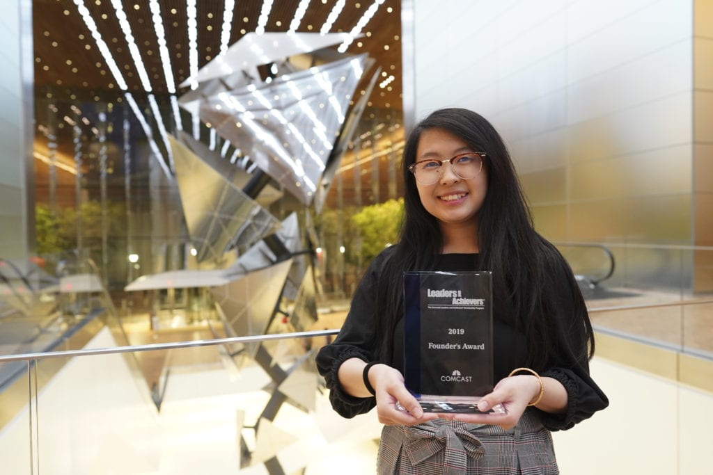"Woman holding a ""Founders Award"""