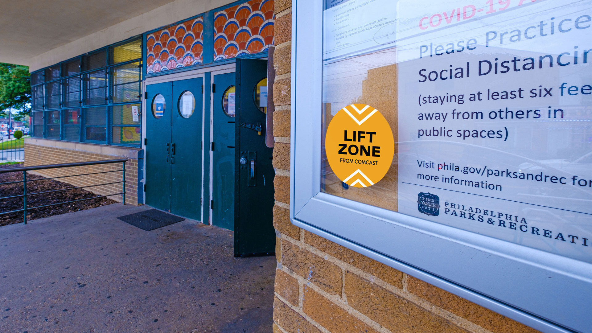 A Lift Zones sticker on a bulletin board.