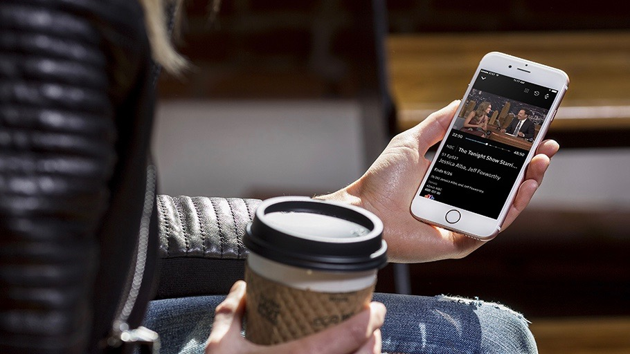 woman holding a phone and coffee