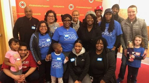 A group of Comcast employees and youth.