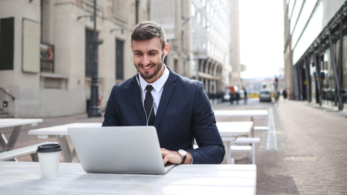 A business owner uses a laptop to do work