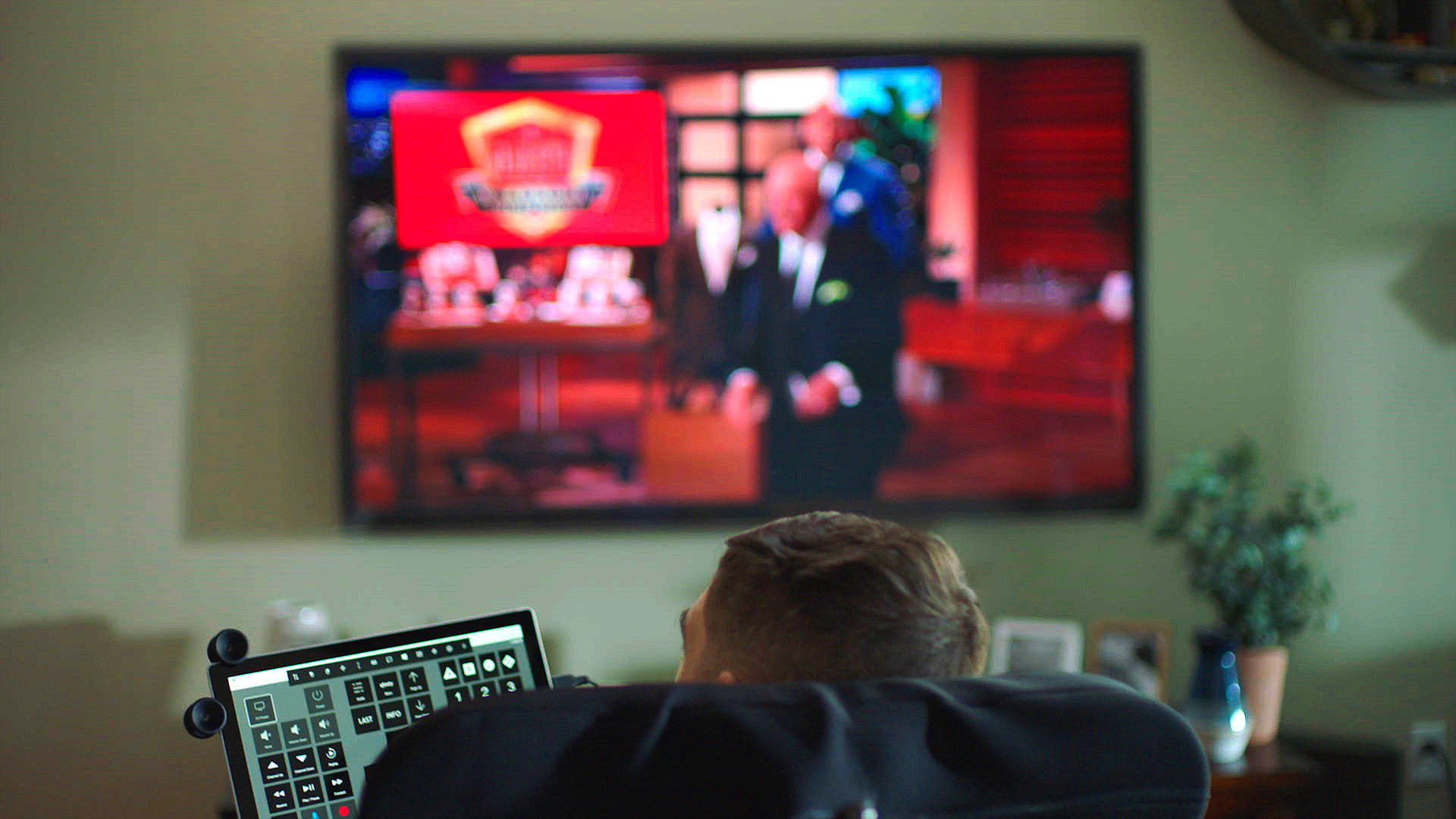 Disabled man watching eye control TV