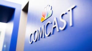 The Comcast logo on a wall.