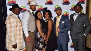 Members of The Utah Black Chamber pose for a photo-op at an event.