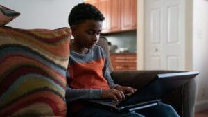 Internet Essentials boy using a laptop