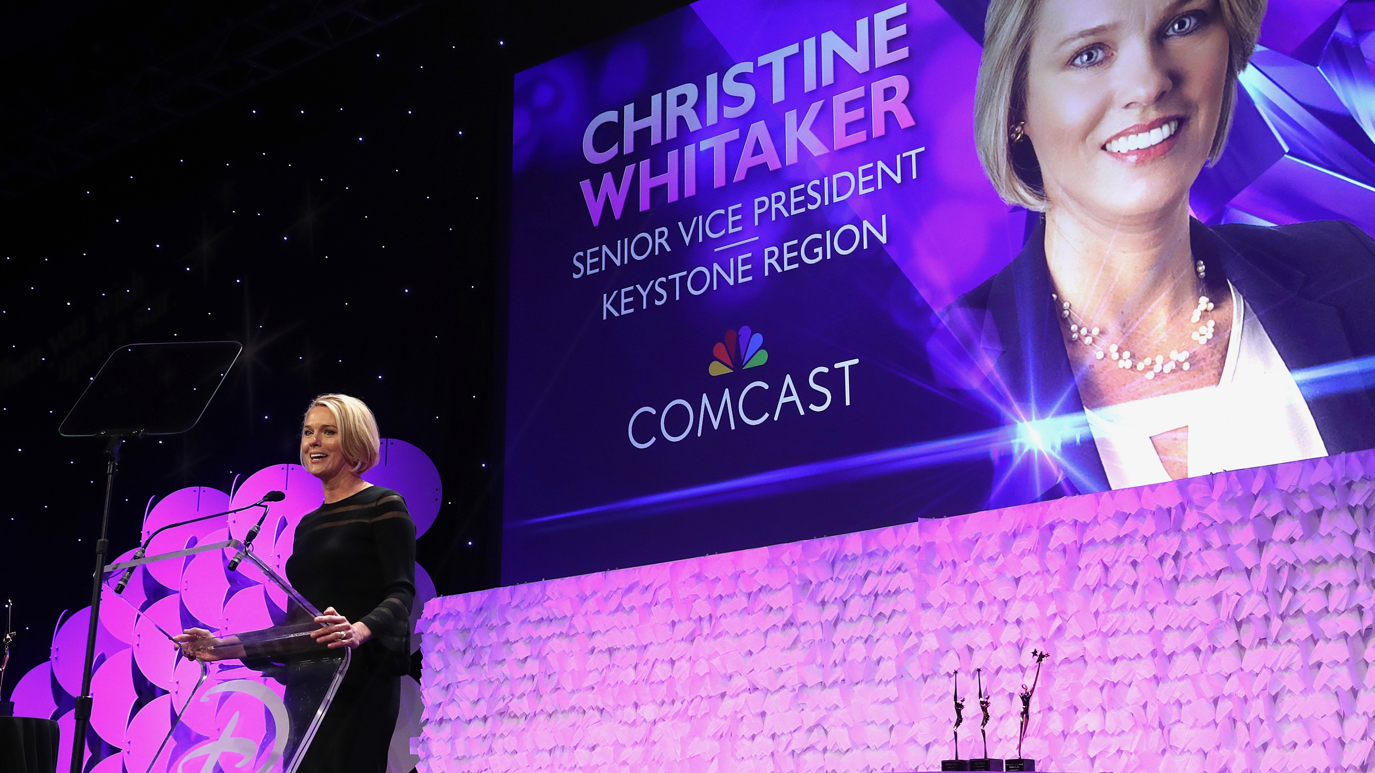 Comcast woman speaking to a crowd