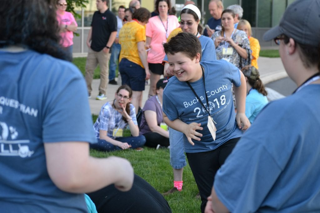 Special Olympics athlete running in a relay race