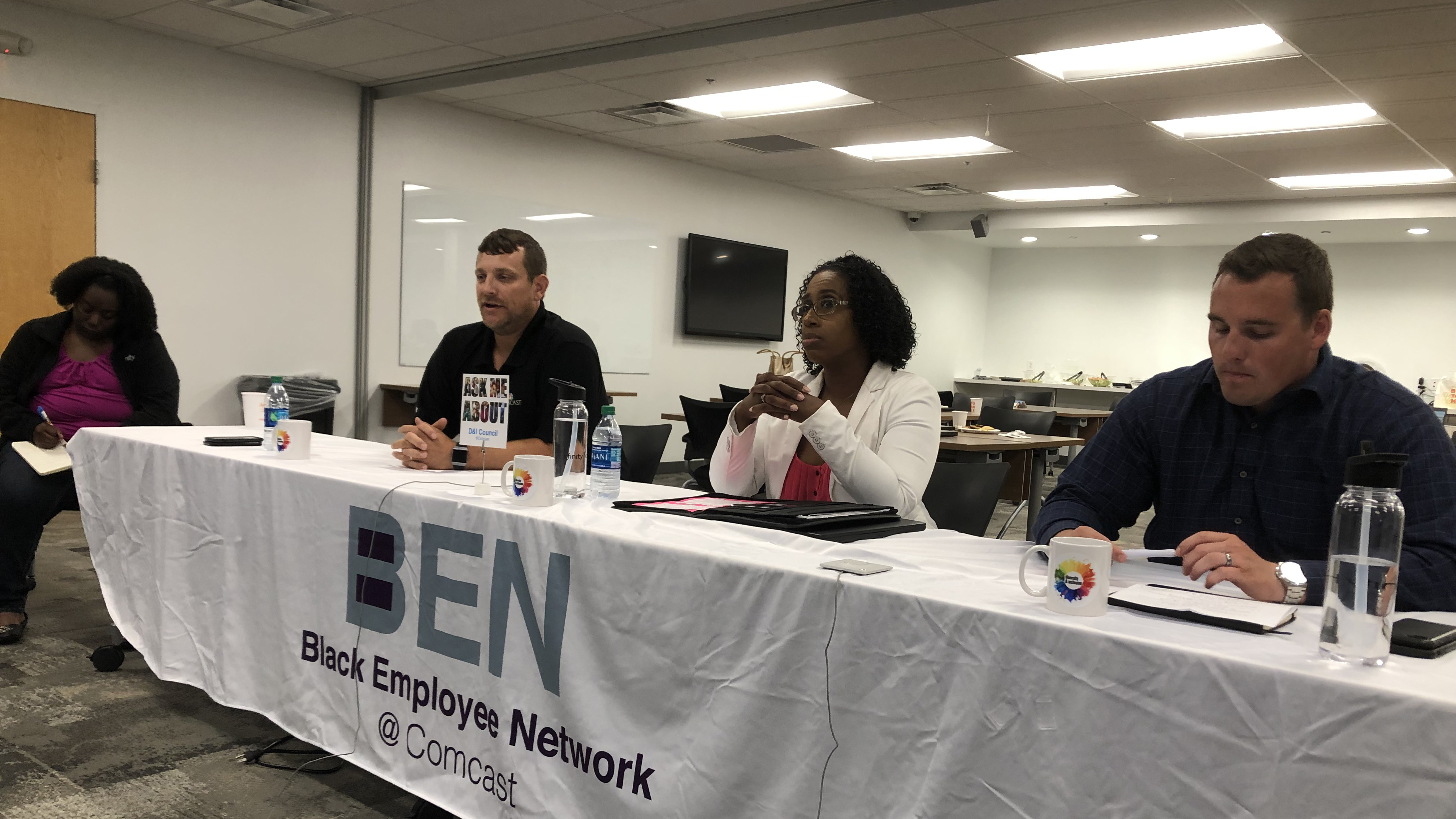 Members of the Black Employee Network sit together at a table.