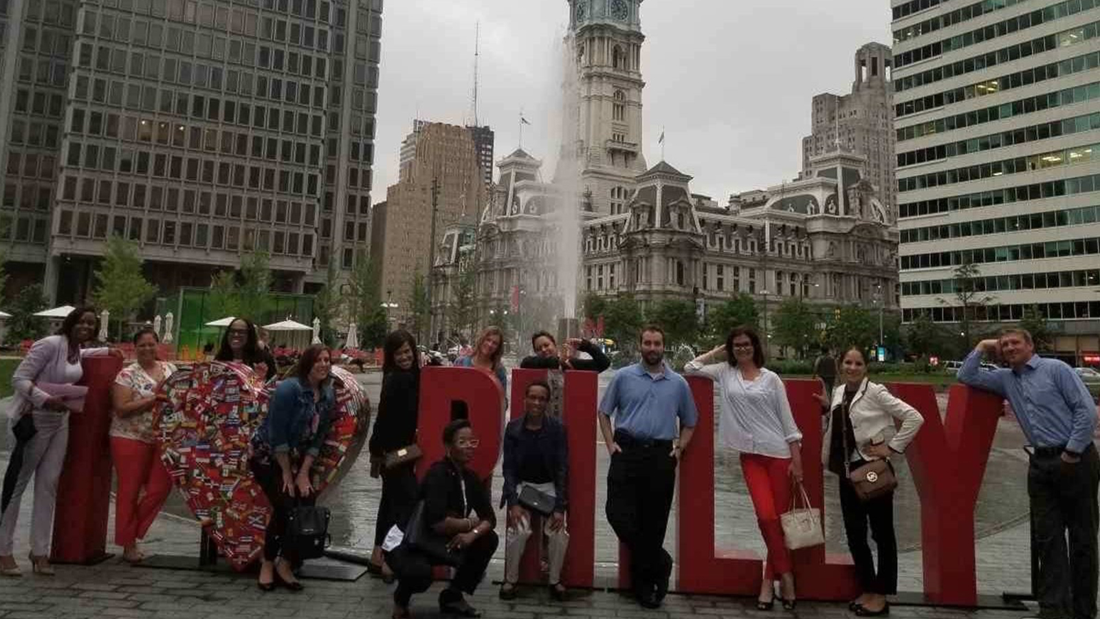 Comcast employees standing together in a Philadelphia park.